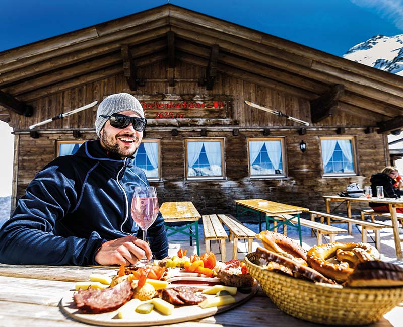 Quaint mountain hut après-ski - or drinks in an exclusive summit bar?